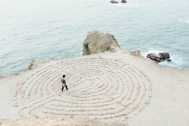 A woman walking through a labyrinth