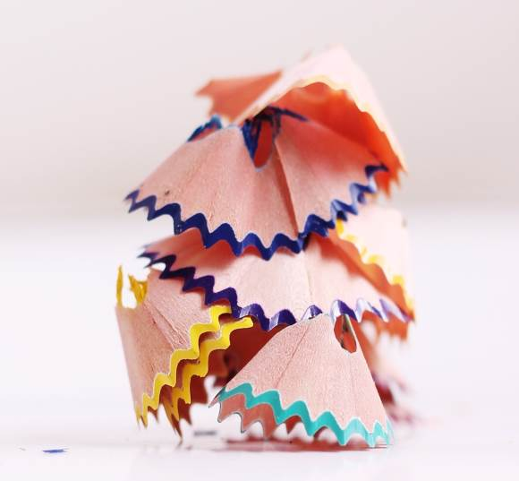 A stack of colored pencil shavings