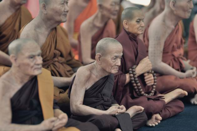A group of monks who would disagree that coloring is the path to spiritual wellbeing