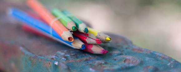 A bundle of broken colored pencils that need to be repaired