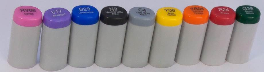 Various Copic Sketch marker caps arranged to show the variety of colors available.