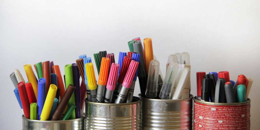 Cans filled with some of the best markers for coloring